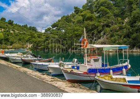 Paxos Island/greece- May 7, 2019: View Of Beautiful Loggos Harbor - Sea Bay With Calm Turquoise Wate