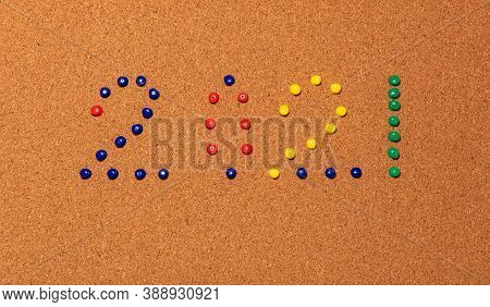 New Year's Number 2021 Compiled Of Blue, Red, Yellow, And Green Paper Pins Across A Brown Cork Notic