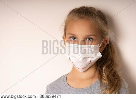 Girl In A Medical Mask With A Painted Smile