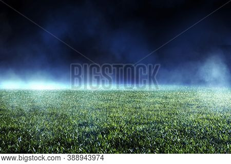 Night Low View Of Maintained Lawn At Football Stadium. Beams Of Light Showing Light Effects At Fog.