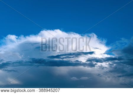 Blue dramatic sky background, white dramatic clouds in the blue sky. Blue sky background, vast sky landscape, sky scene with dramatic clouds.