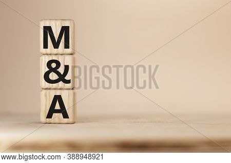 Close-up Shot Of Word M And A Merger And Acquisitionwooden Blocks.