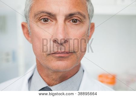 Doctor looking into the camera close up
