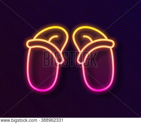 Glowing Neon Line Flip Flops Icon Isolated On Black Background. Beach Slippers Sign. Vector