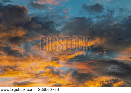 Natural Sunset Sunrise Over A Field Or Meadow. Bright Dramatic Sky And Dark Earth. Rural Landscape U