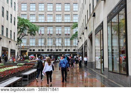 New York, Usa - July 1, 2013: People Shop At Rockefeller Center Promenade In New York. Rockefeller C