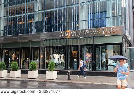New York, Usa - July 1, 2013: People Shop At Armani 5th Avenue, New York. 5th Avenue Is Ranked The M