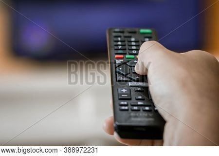Close-up Of Hand With The Remote Control Television And Presses The Button. Television Remote Contro