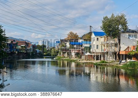 Sochy, Russia - September 14, 2020: The Bank Of The Dagomys River Is Entirely Built Up With Small Co