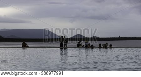 Cairns, Australia - March 19th, 2020: Tourists Enjoying An Infinity Pool On The Cairns, Australia Sh