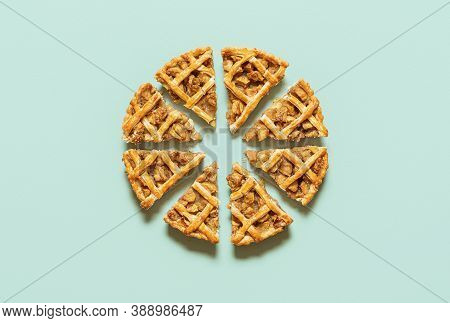 Apple Pie Cut Into Slices, Isolated On Green-mint Seamless Background. Flat Lay With Homemade Apple