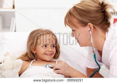 Little girl recovering - checked by friendly health professional with stethoscope