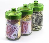 bills euro and dollars in glass banks on white background poster