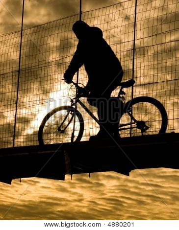 Biker On Suspension Bridge