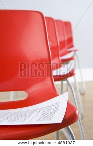Row Of Chairs With Documents