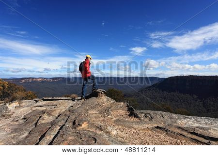 A bushwalker admires the views from Flat Rock Wentworth Falls Blue Mountains Australia poster