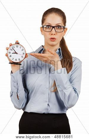 Surprised girl shows the alarm clock in a hand poster