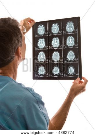 Doctor Viewing Film Of Mri Scans