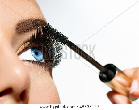 Mascara Applying. Long Lashes closeup. Mascara Brush. Eyelashes extensions. Makeup for Blue Eyes. Eye Make up Apply