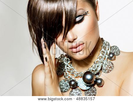 Fashion Model Girl Portrait. Trendy Hair Style. Short Haircut. Hairstyle. Beauty Woman closeup. Fringe. Hairdressing. Silver Metallic Accessories and Manicure