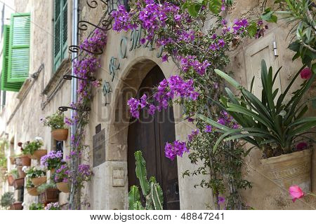 Typical Mediterranean Village With Flower Pots In Facades In Valldemossa, Mallorca, Spain