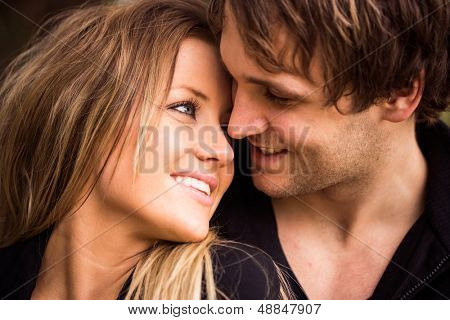 Romantic, tender moment of a young attractive couple. close up portrait