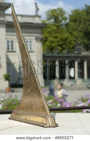 Vertical View Of Sundial In Polish Park.