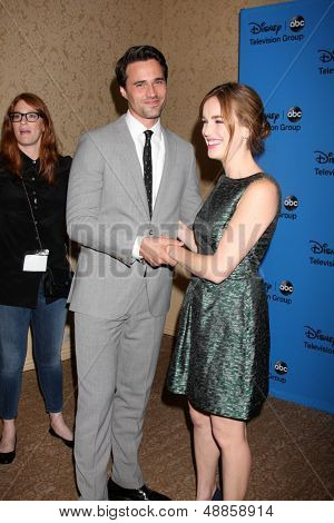 LOS ANGELES - AUG 4:  Brett Dalton, Elizabeth Henstridge arrives at the ABC Summer 2013 TCA Party at the Beverly Hilton Hotel on August 4, 2013 in Beverly Hills, CA