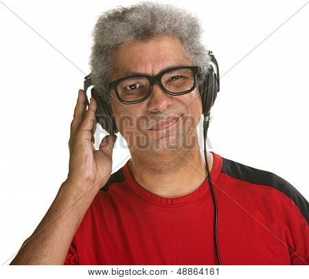 Handsome mature African man squinting with headphones poster