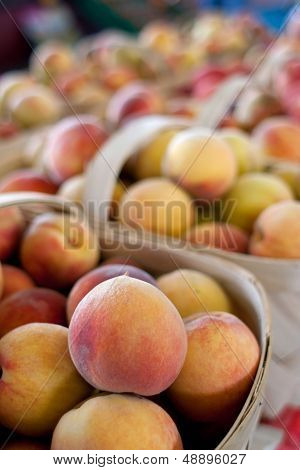 Baskets Of Ripe Peaches For Sale At Farmers Market