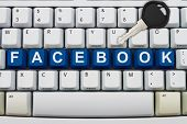 Computer keyboard keys with word Facebook and a key Protecting your Facebook information poster