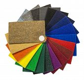 Multi-colored carpeting samples in the form of a fan isolated on white background poster
