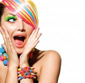 Beauty Girl Portrait with Colorful Makeup, Hair, Nail polish and Accessories. Colourful Studio Shot of Funny Surprised Woman. Vivid Colors. Open Mouth, Emotions poster