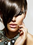 Fashion Model Girl Portrait. Trendy Hair Style. Short Haircut. Hairstyle. Beauty Woman closeup. Fringe. Hairdressing. Silver Metallic Accessories and Manicure poster