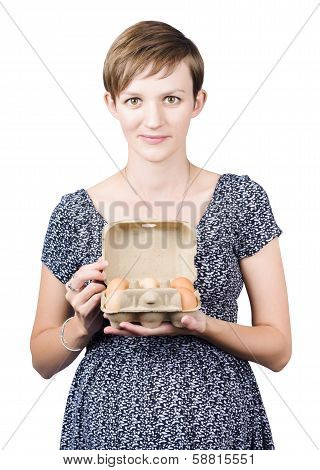 Pregnant Young Woman Displaying A Box Of Eggs