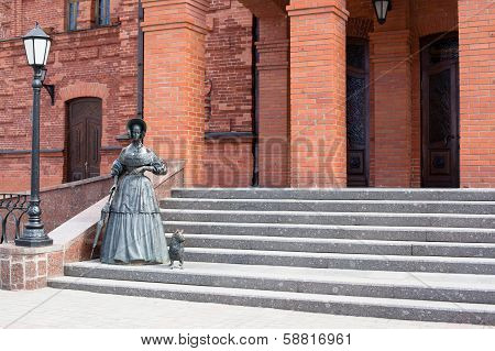 Statue Of Lady With Dog