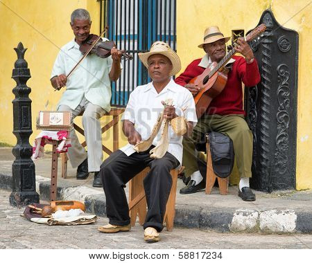 HAVANA,CUBA - JANUARY 15, 2014:Afrocuban street musicians playing traditional music.2 850 000 foreign tourists visited Cuba in 2013,many of them attracted by its distinct culture