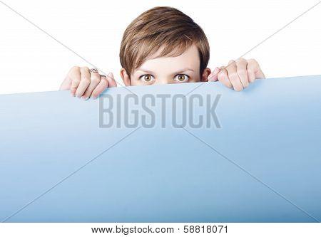 Cute Young Woman Hiding Behind Promo Billboard
