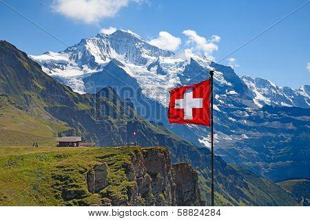 Swiss flag on the top of Mannlichen (Jungfrau region, Bern, Switzerland) poster