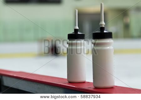 Water Bottles On The Boards In A Hockey Arena