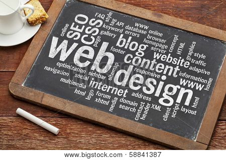 cloud of words or tags related to web design on a  vintage slate blackboard with a chalk and  cup of coffee