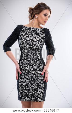 Young modish woman posing in elegant dress