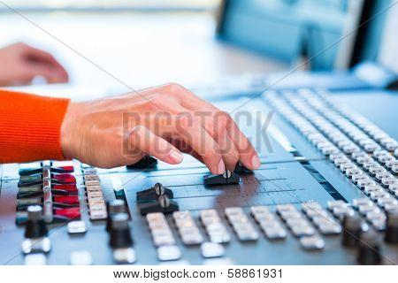 female Presenter in radio station hosting show for radio live in Studio
