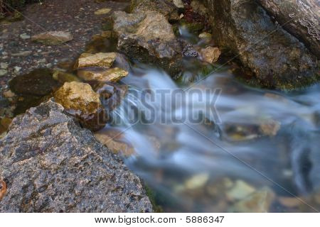 Beautiful River Stream winds it's way across the landscape. poster