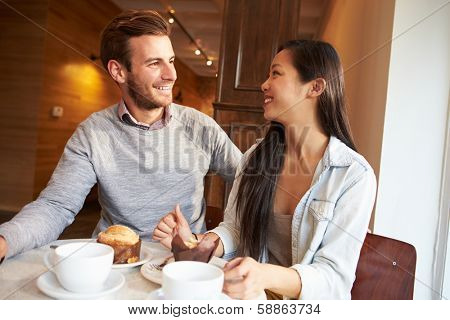 Couple Meeting In Busy Caf���© Restaurant