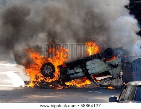 Riots burning car