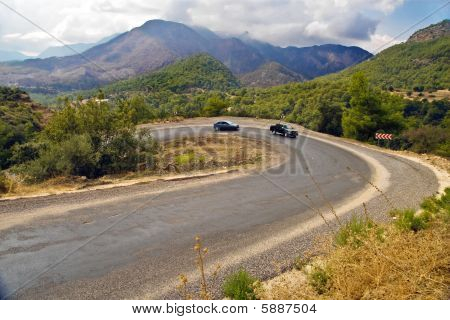 Cars On Serpentine Road In Mountains