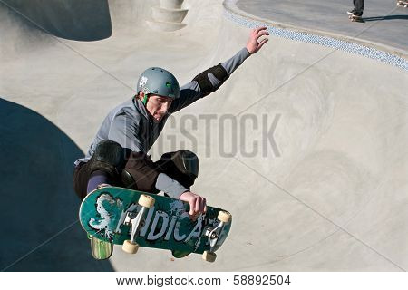 Veteran Skateboarder Catches Air In Bowl At New Skateboard Park