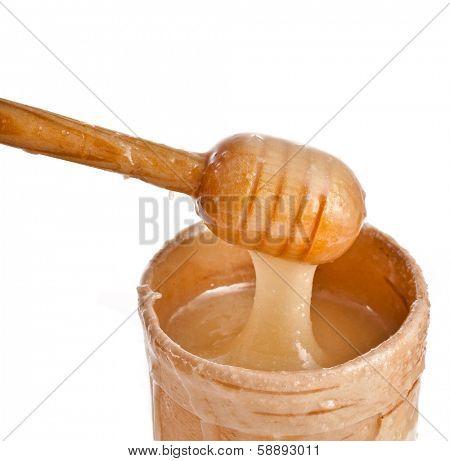 honey and honey stick isolated on white background