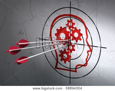 Advertising concept: arrows in Head With Gears target on wall background